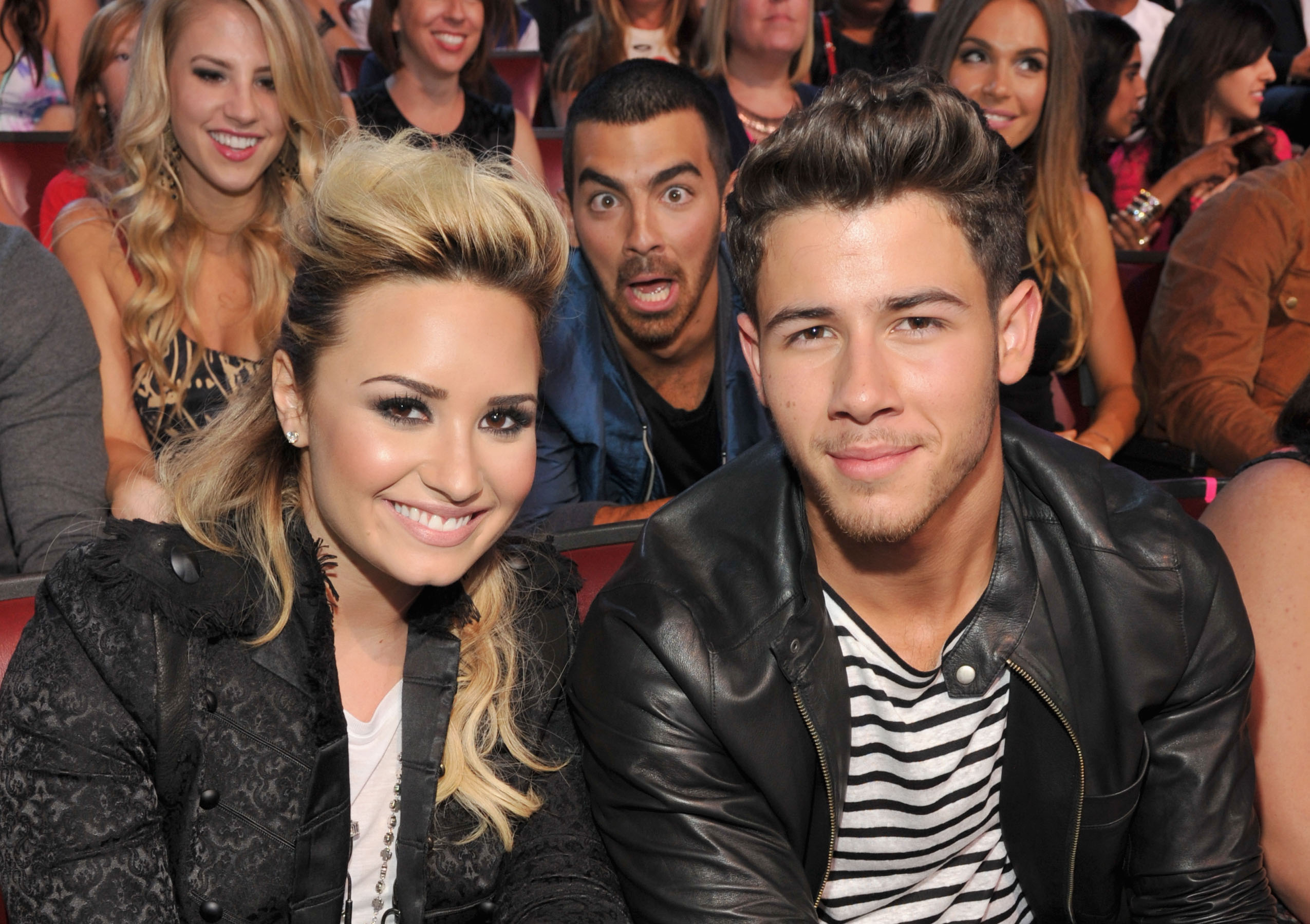 Nick Jonas and Demi Lovato Photobomb