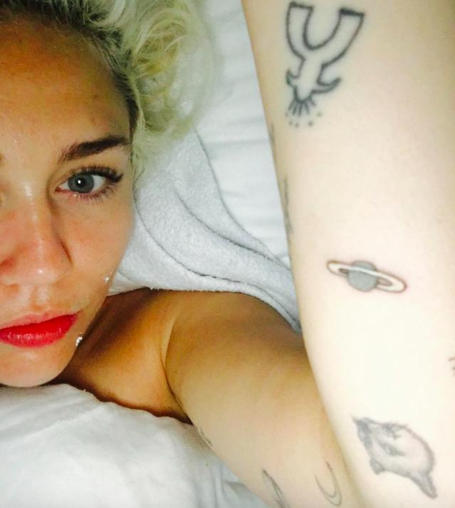 Miley Cyrus new 'Jupiter' planet arm tattoo