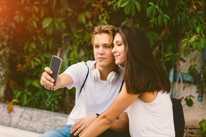 Two teenagers taking a selfie