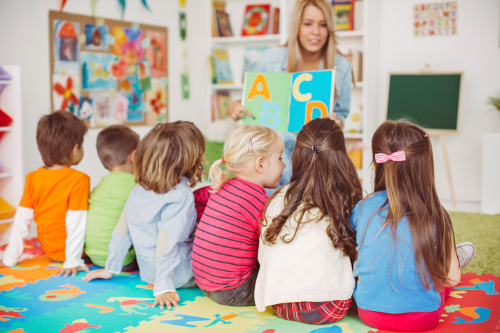 Woman teaching children