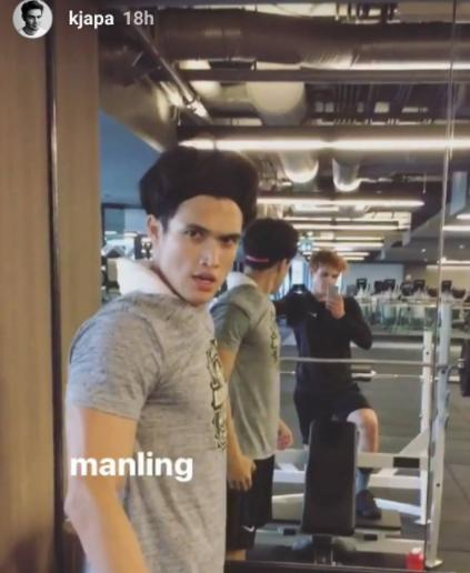 Charles and KJ sitting in a gym
