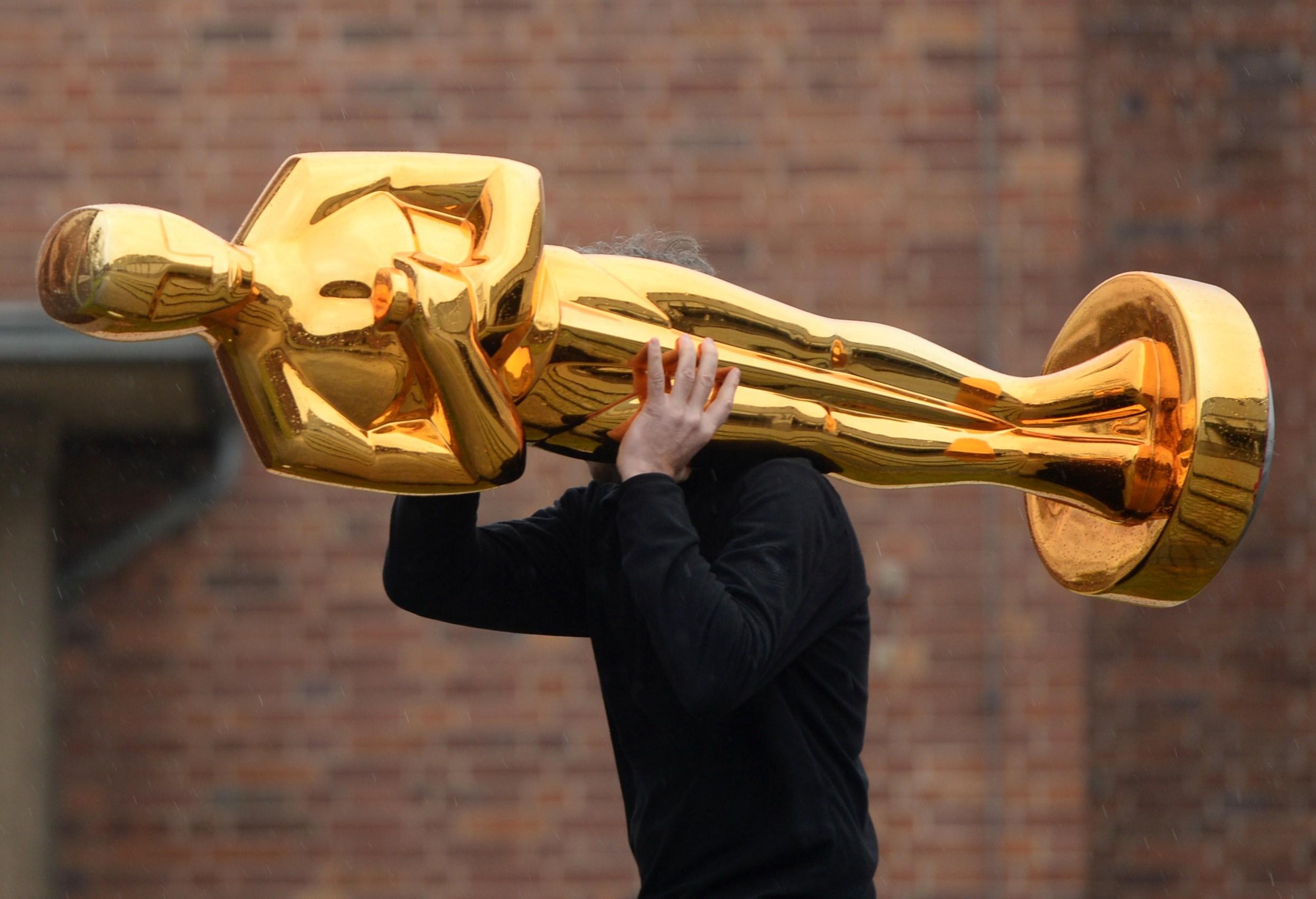 Man Carrying An Oscar