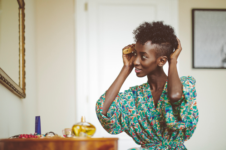 Woman combing through her hair