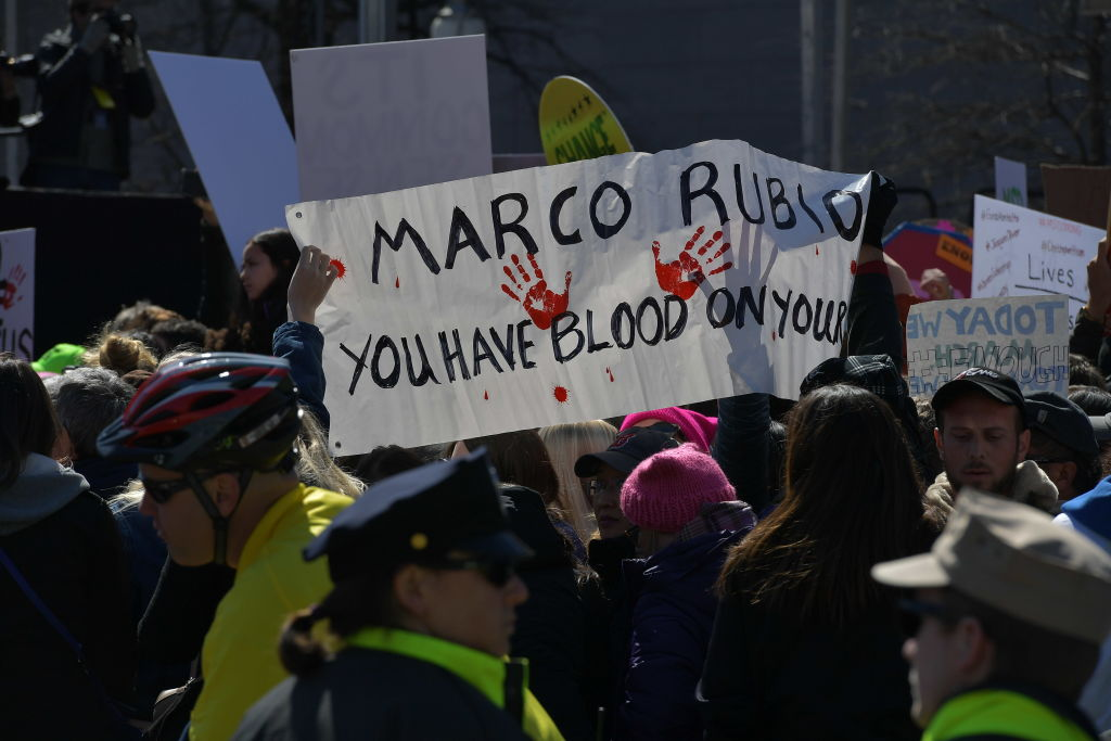 Marco Rubio protest sign